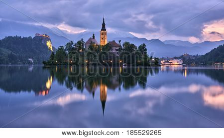Church of the Assumption in Lake Bled with the castle in the background Slovenia