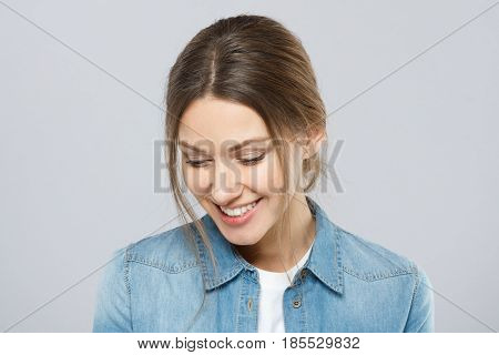 Portrait Of Beautiful European Lady With Simple Hairstyle And Light Everyday Makeup Isolated On Grey