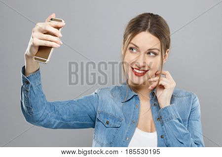 Photo Of Attractive Woman With Makeup Isolated On Grey Background Touching Her Cheek With Fingers An