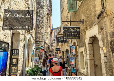 St Paul de Vence, France - June 30, 2016: typical narrow street with tourists and art shops in St Paul de Vence France. It is a popular destination for a large number of artists poets and writers