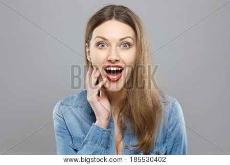 Photo Of Young European Lady Isolated On Grey Background Extremely Surprised With Mouth And Eyes Ope