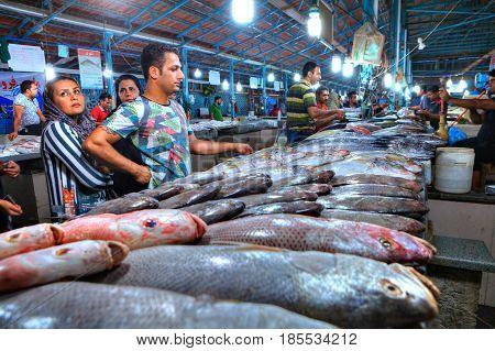 Bandar Abbas Hormozgan Province Iran - 15 april 2017: Muslim buyers choose fresh fish in the indoor fish market.