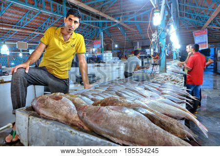 Bandar Abbas Hormozgan Province Iran - 15 april 2017: The seller of fish in the indoor fish market stands near their products.