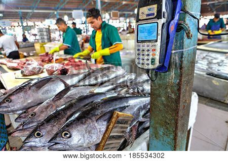Bandar Abbas Hormozgan Province Iran - 16 april 2017: A portable mobile terminal for payment by a bank card is placed on the construction of an indoor fish market.