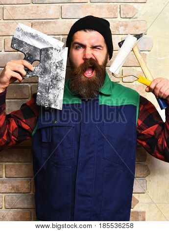 Bearded Painter Man Holding Various Building Tools With Satisfied Face