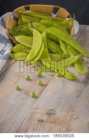 Fresh snow peas on wooden table background