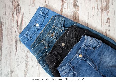 Four Jeans Of Different Colors, Assortment. Fashionable Concept. Top View