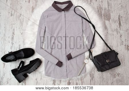 Gray Shirt, Black Shoes And Handbag On A Wooden Background. Fashionable Concept, Top View