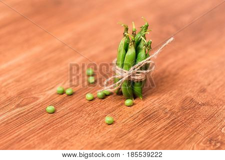 Green peas decorated as a gift. Eco packaging of fresh green peas in pods
