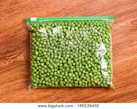 Green peas prepare for freezing. Green peas in a transparent vacuum package