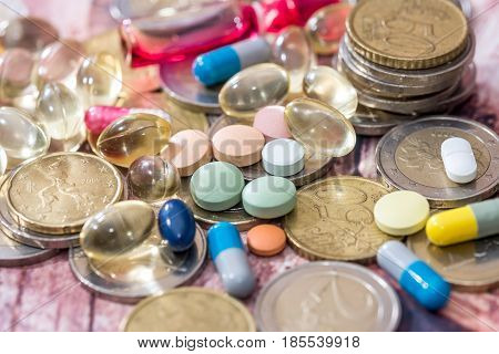 Fish oil pill omega 3 with euro coin