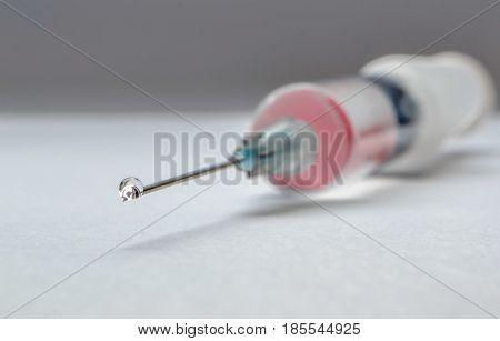 Close up phpto of drop on syringe needle
