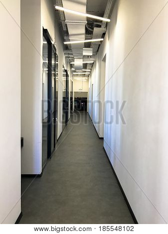 Empty modern coworking space office with glass walls