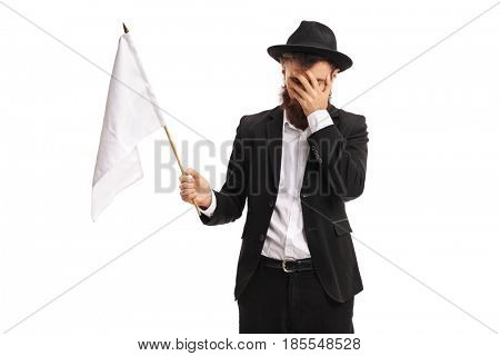 Man with a white flag holding his head in disbelief isolated on white background