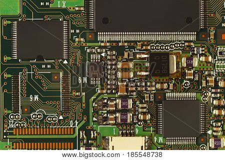 Electronic circuit board with microchips from a modern device close up.
