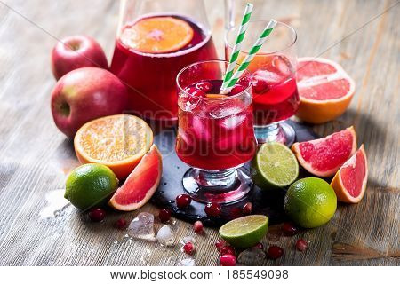 Citrus lemonade refreshing summer drink with ice cubes and fruits lime grapefruit apples sangria