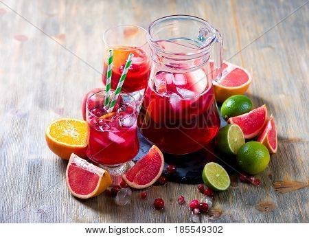 Sangria in pitcher with ice and citrus fruits homemade refreshing lemonade drink
