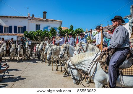 Sent-Mari-de-la-Mer, Provence, France - May 25, 2015. Guards on white horses before the start of the parade. World Festival of Gypsies. The concept of ethnographic and active tourism