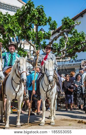Sent-Mari-de-la-Mer, Provence, France - May 25, 2015. Two guards on  white horses are waiting for the parade. World Gypsy Festival. The concept of ethnographic and active tourism