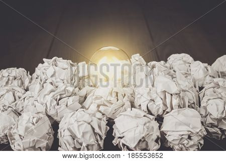 idea concept with crumpled office paper and light bulb