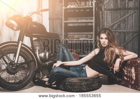 Girl Lying In Dirty Rubber Tire On Floor