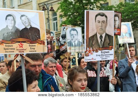 KURSK RUSSIA - May 92017: Immortal Regiment procession in Victory Day- hundreds of people marching toward the Red Square with flags and portraits.