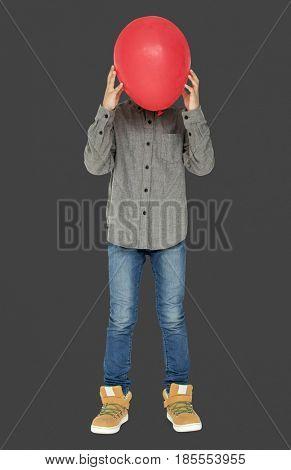 Little Boy Hide Face by Red Balloon Studio Portrait