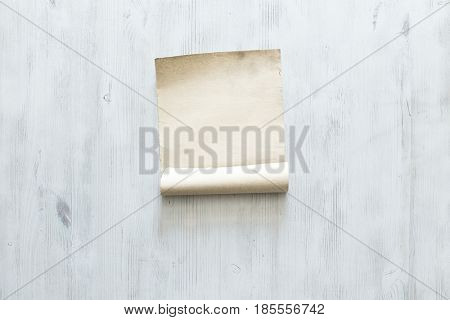 old paper on blue wooden wall, retro background