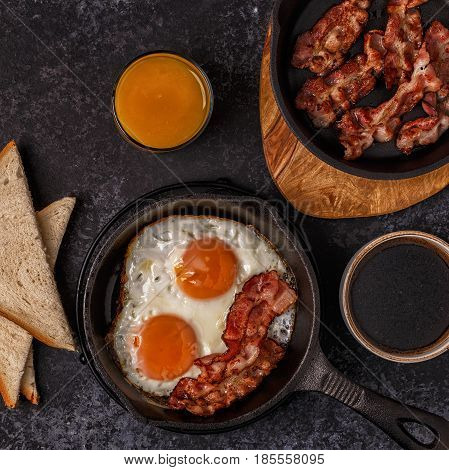 Breakfast With Bacon , Fried Egg, Coffee And Orange Juice.