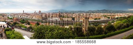 panorama of Florence with Ponte vecchio and beautiful renaissance cathedral Santa Maria del Fiore in Florence, Italy