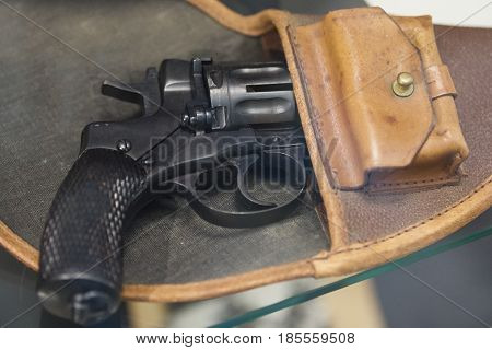 Old Russian revolver in a holster - soviet weapon, background