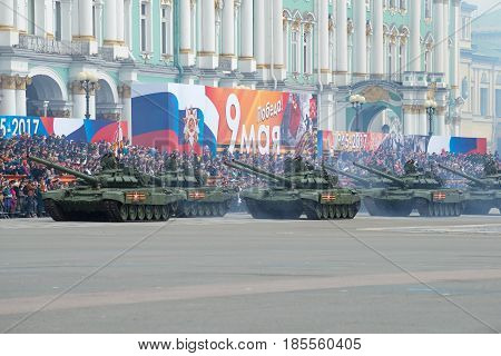 SAINT PETERSBURG, RUSSIA - MAY 07, 2017: Column of Soviet tanks T-72B3 in the Palace square. Dress rehearsal of parade in honor of Victory Day