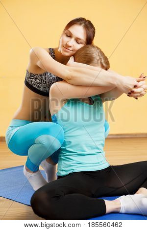 Photos of girls in gym practicing yoga