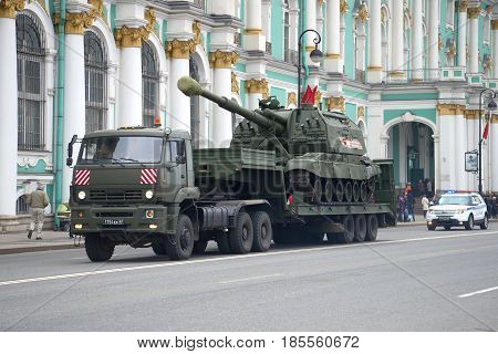 SAINT-PETERSBURG, RUSSIA - MAY 07, 2017: Transportation of the Msta-S self-propelled artillery vehicle by Kamaz-65225 truck. Preparations for the parade in honor of Victory Day