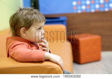 Boy Sitting On Sofa