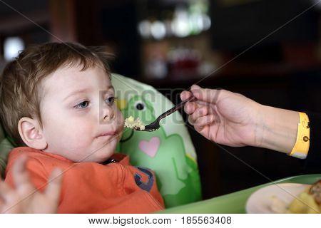 Mother Feeding Her Son Omelet