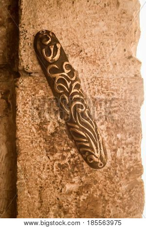 The Mezuzah affixed to the doorpost at entrance to Zion Gate in the Old City of Jerusalem Israel