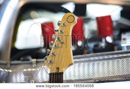 Headstock of the six string classic electric guitar on white background