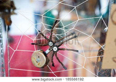 Steampunk spider. Chrome and bronze parts. On spider web.