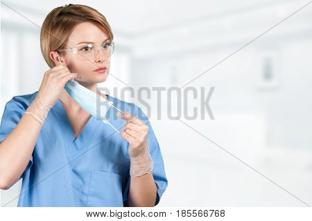 Doctor With Surgical Mask In Hospital