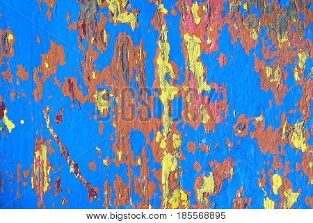 Texture of an old painted crusty wooden board