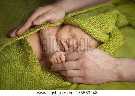Newborn Baby Sleep in Parent Hands Sleeping New Born Kid Child and Family concept