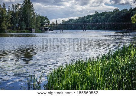 Bridge of Pripyat River backwater seen from Chernobyl village Ukraine