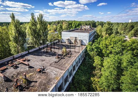 On the roof of former factory in Pripyat desolate city in Chernobyl Exclusion Zone Ukraine