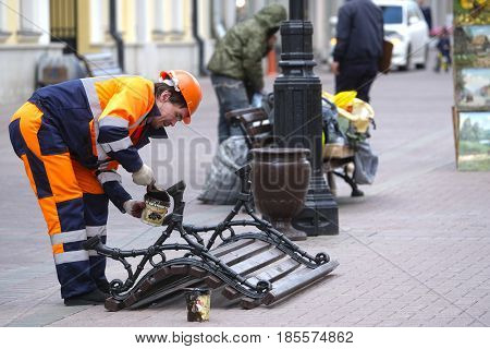 Moscow, Russia - May, 4, 2017: Municipal worker works on Moscow street