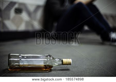 Liquor Alcohol Bottle Lying on The Floor