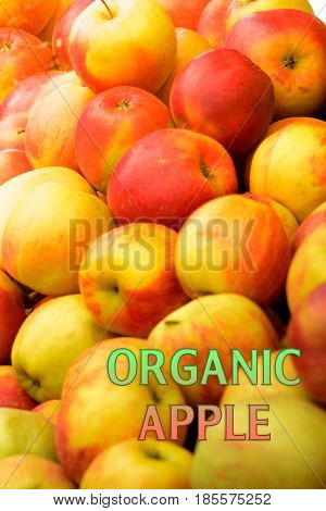 Organic garden apples with water drops and the inscription organi on a white sheet.