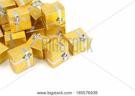 Close up of a pile of gold gifts on white background