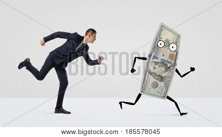 A businessman running after a confused dollar bill with arms and legs. Run after money. Best paying job. Easy to earn.