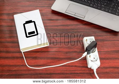 Book Charging On A Desk